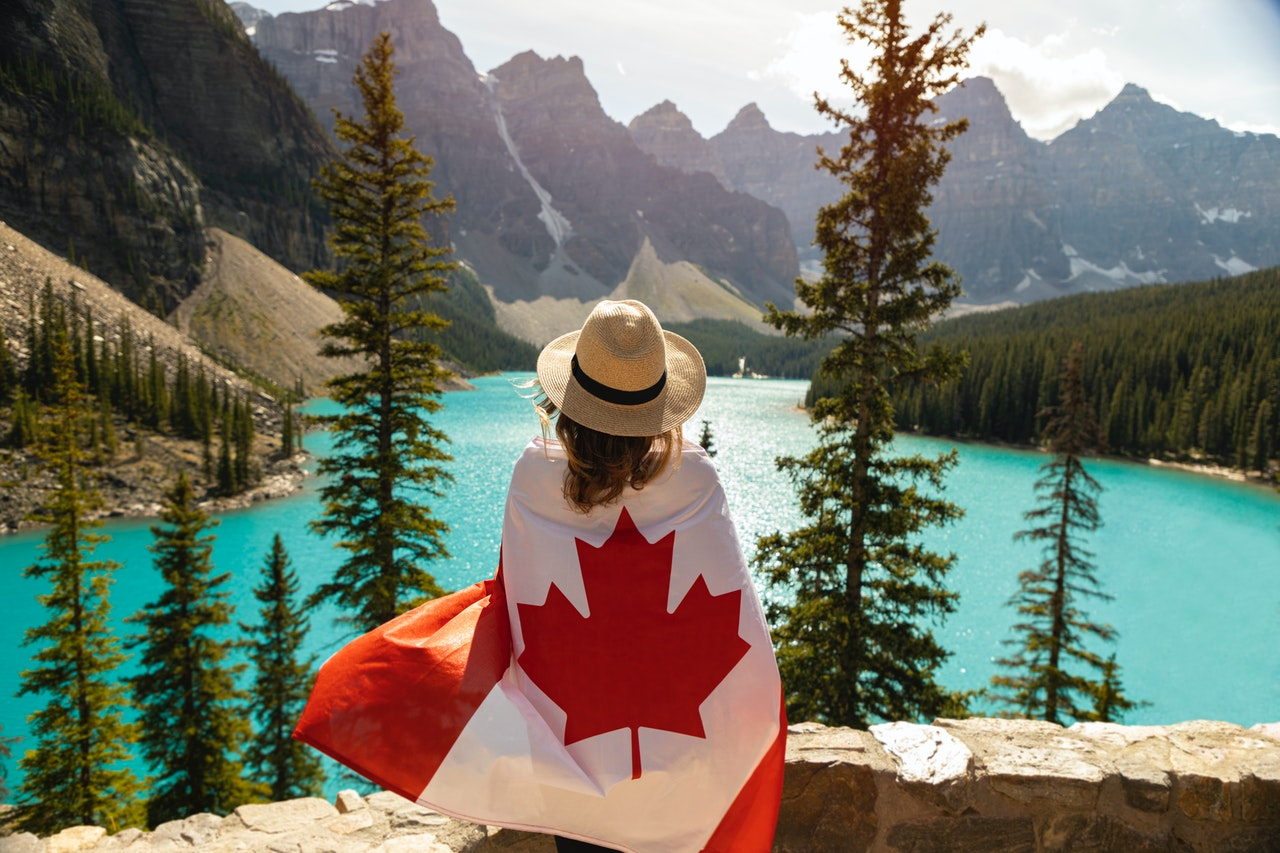woman-draped-in-a-flag-of-canada-2916826 (1)